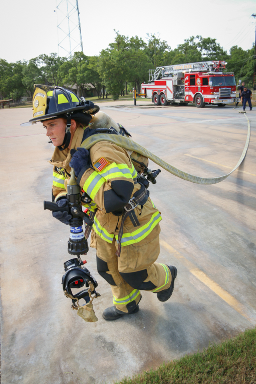 Fire Department - Firefighter Carrying Hose-1